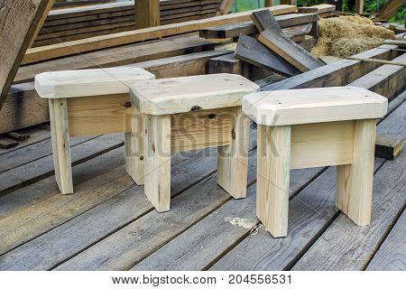 Three wooden stools made by hand. The natural tree is untreated. Work carpenter. Interior (element) of the children's play house