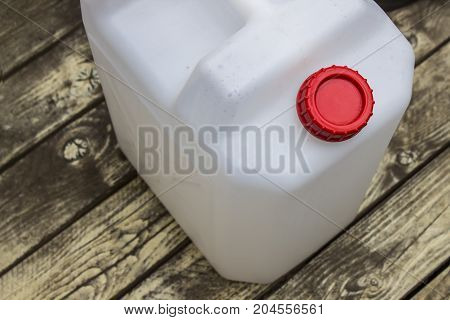 One Gallon Container, white and red plastic