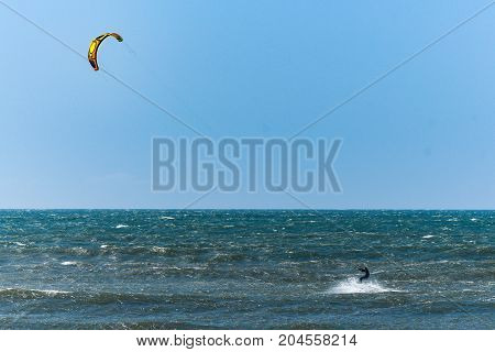 Kitesurfer Riding Ocean Waves