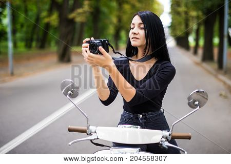 Young Beautiful Hipster Woman Riding With Photo Camera On Motorbike City Street, Taking Pictures.