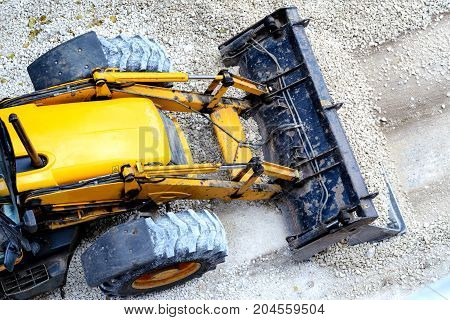 Yellow Bulldozer, Loading Gravel For Road Construction