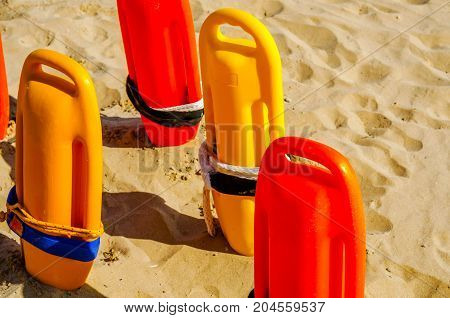 close up of a rescue buoys in the sand of a beach in the Mediterranean sea safety vacation rescue tool yellow sand