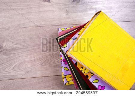 Hardback Books On Bright Colorful Background.