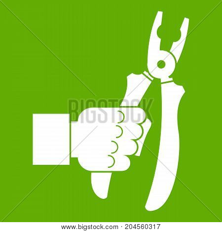 Hand holding chisel icon white isolated on green background. Vector illustration