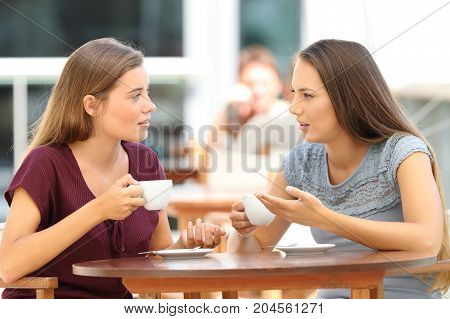 Serious Friends Talking In A Restaurant