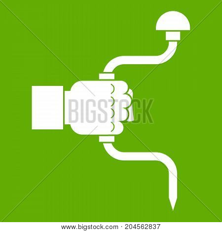 Vintage hand drill in man hand icon white isolated on green background. Vector illustration