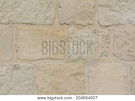 Light beige stone blocks of an ancient wall