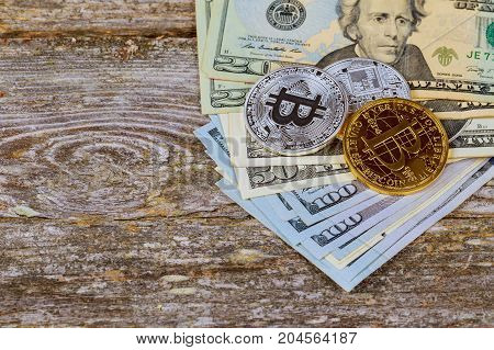 Coin Bitcoin On The Background Of A Pile Of Dollar Bills