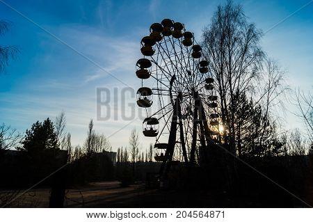 old broken Ferris wheel in Pripyat after accident