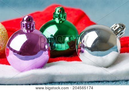 Colorful decoration Christmas ball with Santa Claus hat
