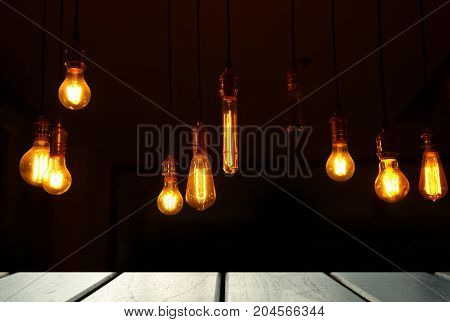 bar lamp light with black top table wood display background at dark night