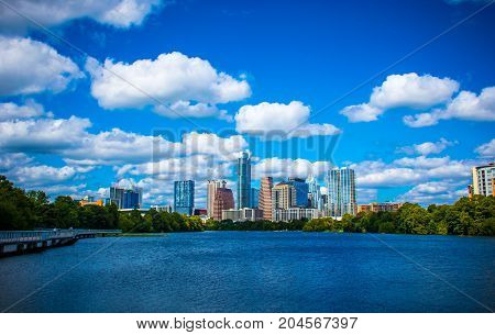 Blue City on Lady Bird Lake Austin Texas Skyline Cityscape at the pedestrian bridge lookout over Town Lake SKyscrapers and tall Towers line the Downtown Capital City