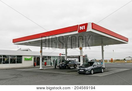 Iceland August 24 2017: A couple of cars are receiving gasoline at an N1 gas station.