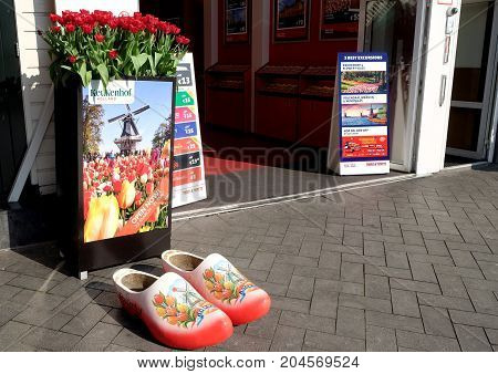 AMSTERDAM NETHERLANDS - MAY 13 2017: National wooden shoes are in front of the entrance to the tourist office
