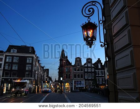 AMSTERDAM NETHERLANDS - MAY 14 2017: Evening illumination in the historical part of Amsterdam