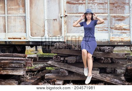Asian Lady Post On Old Cassage Train In Adventure Concept