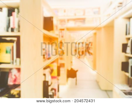 Abstract blur image of a bookstore .
