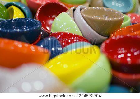 Numerous tiny colorful ceramic tea cups - background