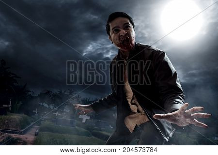 Halloween concept angry vampire on graveyard at night