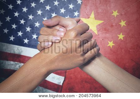 Concept of peace. two hands people posing partnership with China and United States flag in the background