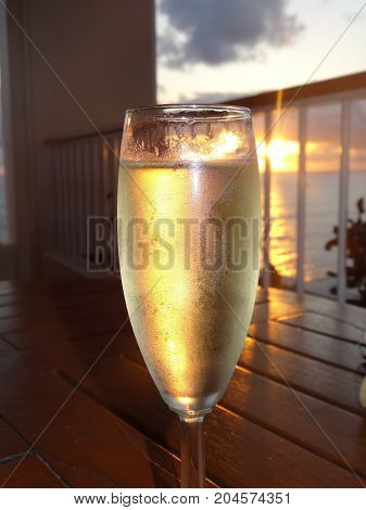 Glass of Champagne in Hawaiian Paradise at Sunset