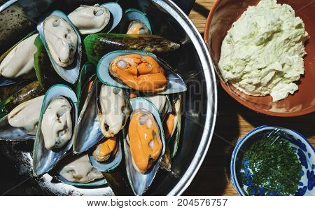 Fresh mussel shellfish, preparation seafood ingredients for Mussel with butter and garlic meal. Top view