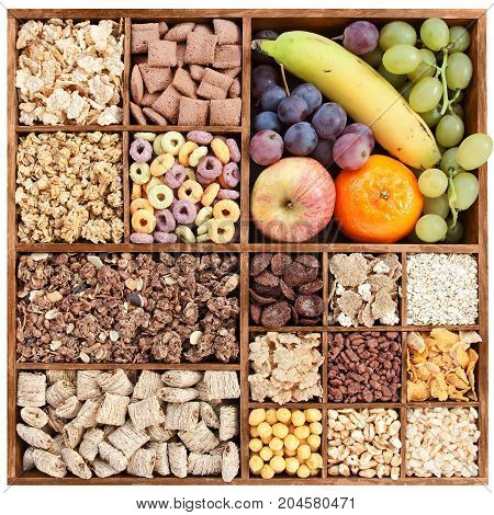 assorted cereals in wooden box with fresh fruits (manual focus)