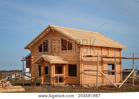 New wooden house built from logs, ecological wooden building, unfinished.