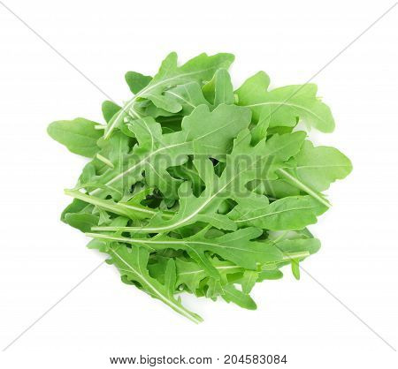 Heap of green rucola rocket salad or arugula isolated on white background. Top view.