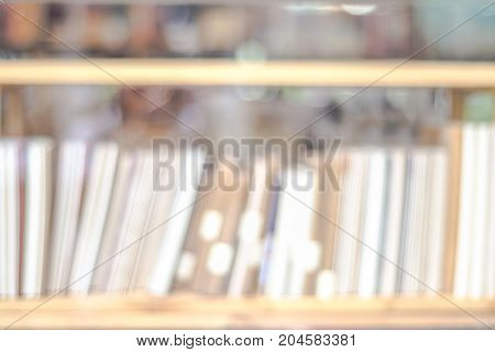 Blurred background Blur bookshelves at book store background education concept