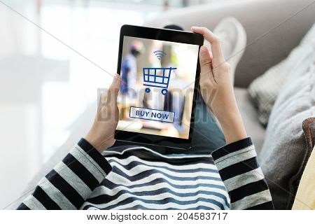 Woman hand using tablet with shopping online device on screen background business and technology digital marketing lifestyle concept