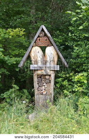 A wild bee hotel at the edge of forest