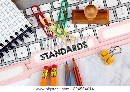 Standards concept. Folder Register on Background of Computer Keyboard.