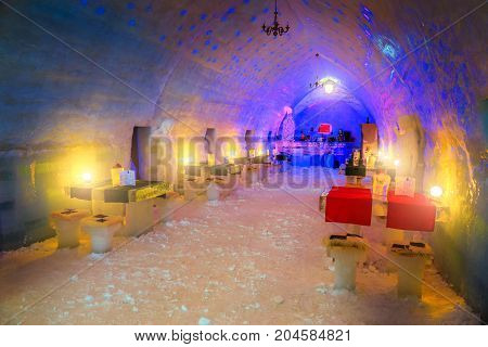ICE HOTEL - BALEA LAKE ROMANIA - FEBRUARY 11 2017: Winter landscape Amazing famous ice hotel and bar with equipment on the frozen Balea lake in Fagaras mountains Carpathians Transylvania Romania Europe FEBRUARY 11 2017 Balea Lake Romania