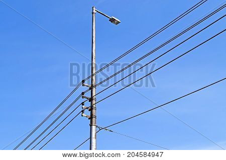 Air lead electricity cables against blue sky
