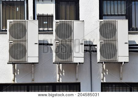 Large air conditioners on the wall of a building