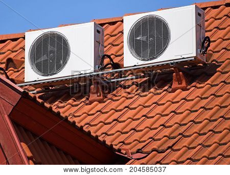 Air conditioners on the roof of a house