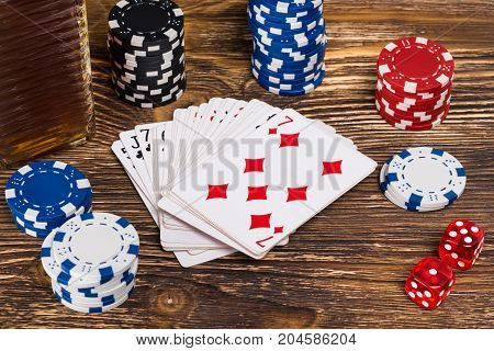 on a wooden table play poker close-up of chips and poker cards