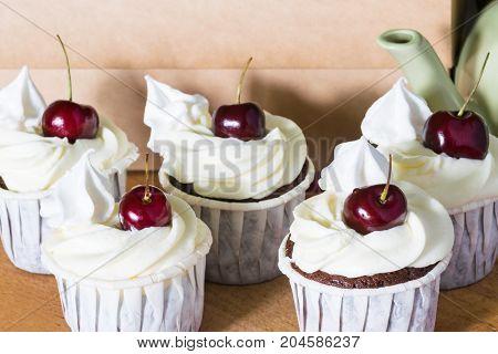 five cherry cakes with cream for tea