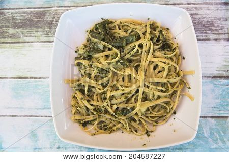 Traditionally Styled Fettuccine Served with Fresh Pesto along with Beans and Potatoes in Cornigilia, Italy