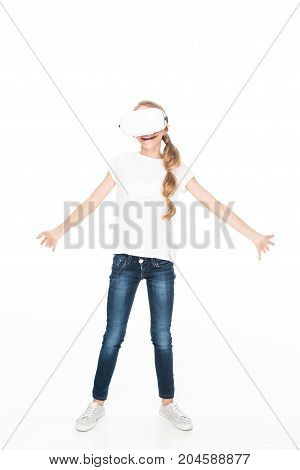 excited female teenager using Virtual reality headset isolated on white