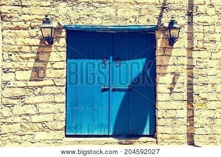Ancient Brick Wall And Wooden Door.