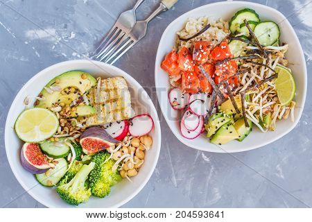 healthy lunch buddha salad bowls ahi poke. concrete background healthy vegan trend food concept. poster