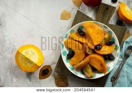 Pumpkin Baked With Apples, Prunes And Spices In A Bowl On A Stone Background. Flat Flay, Top View Wi