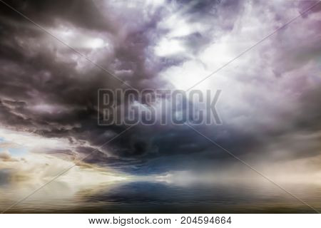 Fantasy cloudscape over water with UFO craft lights coming though the clouds