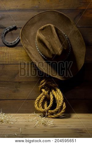 Accessories cowboy hanging on old wooden wall ranch