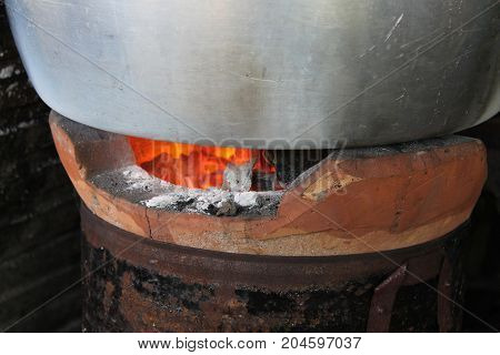 Cooking with rustic charcoal stove by heat.