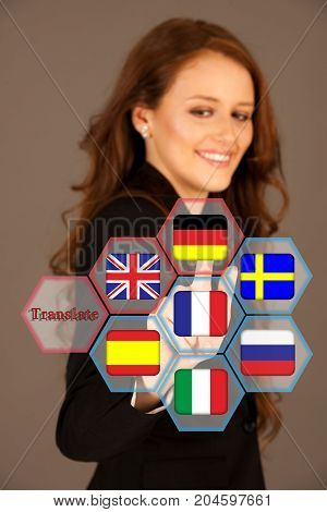 Attractive business woman pressing a translate virtual button
