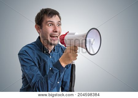 Young Man Is Announcing News With Megaphone.