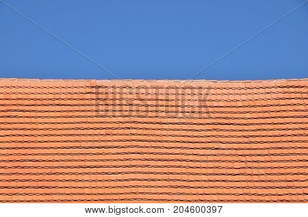 Red Brown Ceramic Roof Tiles Over Blue Sky